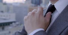 Asian American business man loosens tie and drinks beer 4K - stock footage