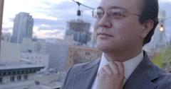 Business man loosens tie and drinks beer 4K - stock footage