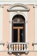 Decorated door window of an Italian neoclassical villa. - stock photo