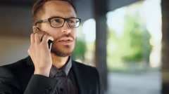 Portrait of young successful business man having cell telephone Stock Footage