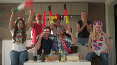 Friends cheering teams of different countries Stock Footage