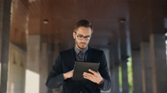 Young bearded businessman writting business e-mail using his tablet pc Stock Footage