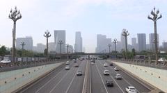 Busy traffics go through the underpass tunnel Stock Footage