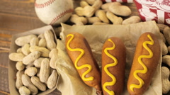 The camera moves over the table with a snack for fans of the game in baseball Arkistovideo