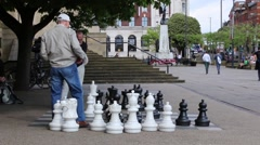 Men Playing Chess In The City Centre, Leeds, England Stock Footage