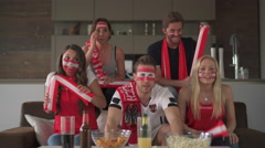 Frustrated austrian soccer fans at home Stock Footage