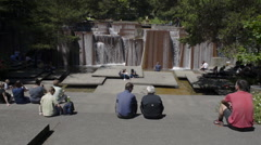 Keller Fountain on a sunny day with many people sitting around it, eating lunch - stock footage