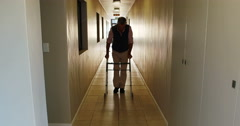 Patient walking with zimmer frame Stock Footage