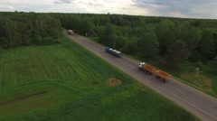4K HD local road traffic trucks lorries vans cars drive one direction birds eye  Stock Footage