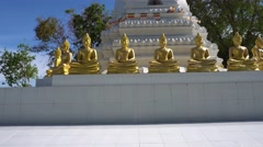 White pagoda with golden Buddha statues Stock Footage