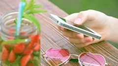 Girl using a cell phone outdoors. Stock Footage