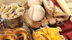 Baseball party food with gloves and ball on the table Stock Footage