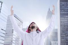 Arabic man praying in the city Stock Photos