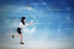 Businesswoman running inside cyberspace Stock Photos