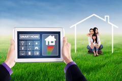 Smart home apps and joyful family Stock Photos
