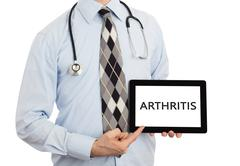 Doctor holding tablet - Arthritis Stock Photos