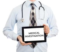 Doctor holding tablet - Medical investigation - stock photo