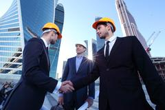 Investor and contractor shaking hands Stock Photos