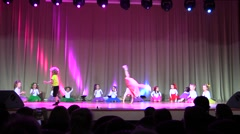 Children's Acrobatic stunt dance performance on concert hall stage Stock Footage