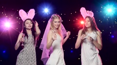 Bride, girlfriends dancing, drinking champagne blowing kisses at bachelorette - stock footage