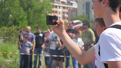 Man spectator shooting video via smart phone watching a show performance Stock Footage