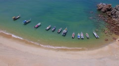 Aerial view of boats at ocean shore under blue sky. Stock Footage