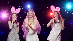 Girls having fun at bachelorette party and blowing soap bubbles Stock Footage