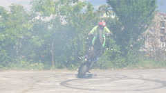 Motor show man rides motorcycle for tricks stunts entertaining public - stock footage