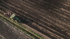 Aerial: Tractor Cultivating a Field - stock footage