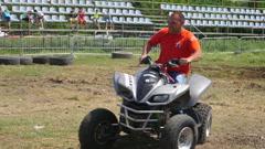 Man rides an ATV motor on a car derby show entertain public Stock Footage