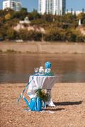 Table with wedding accessories, outdoors, in blue and white style Stock Photos