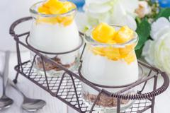 Breakfast dessert with bran flakes, plain yogurt and mango, closeup Stock Photos