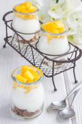 Breakfast dessert with bran flakes, plain yogurt and mango - stock photo