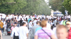 The anonymous crowd in white shirts running away from the camera Stock Footage