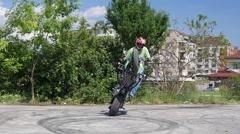 Motor show man rides motorcycle for tricks stunts entertaining public slow - stock footage