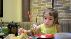 children, girl eating sandwiches in the cafe. french fries - stock footage