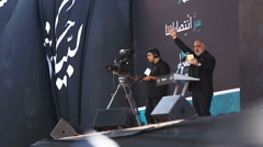 Speaker introduces Nasrallah speech during ceremony Stock Footage
