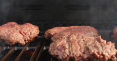 Grilling Hamburgers and Flipping Burger Over Dolly Shot, 4K  Stock Footage