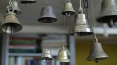 The swinging of many suspended metal bells in the room - stock footage