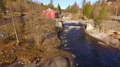Flights over Norway rough river bridge and the house 2 Stock Footage
