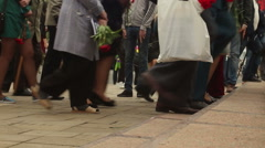 Anonymous crowd climbing stairs from left to right with flowers Stock Footage