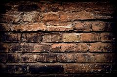 Old brick wall, aged brick background or texture Stock Photos