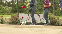People laid flowers at the memorial plaque - stock footage