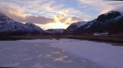 Flights over Norway snow mountains lake in the ice Stock Footage