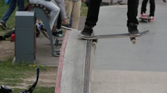 Crooked grinde trick with the skateboard in skate park Stock Footage