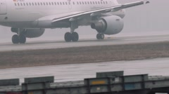 Wheels and turbines of an airbus a319-100 moving on a runway in the airport Stock Footage