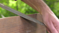 Using a wood rasp on the edge of a board - stock footage