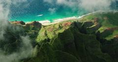 Aerial view flying over jungle mountain peaks, Na Pali coast Kauai Stock Footage