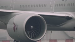 Close up super tele shot of turbines of an 777 300ER boeing moving on a runway Stock Footage