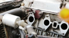Mechanic installs laying Stock Footage